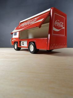 1960s COCA-COLA metal toy truck by BUDDY L/ side opens up $30. I have mine from when i was a kid.