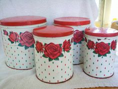 Set of 4 vintage kitchen tin canisters with lovely roses, nesting