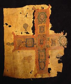 COPTIC TEXTILE. Egypt, Christian Period, c. 4th-6th century AD. Double-weave fabric with large ornate early Christian cross, bird(s) & chalices in the field. Right edge lost. 8.5 x 10 inches