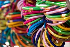 Bangles are traditional ornaments worn mostly by South Asian women in India and Bangladesh, especially Hindus (their name derives from Hindi bungri (glass).Bangles are circular in shape, and, unlike bracelets, are not flexible. They are made of numerous precious as well as non-precious materials such as gold, silver, platinum, glass, wood, ferrous metals, plastic.