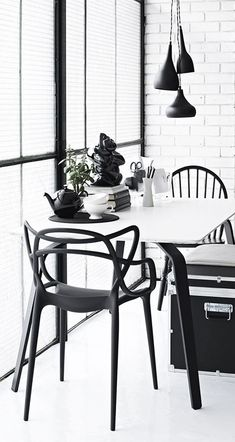"""The Kartell Masters Chair, designed by Philippe Starck is a tribute to the iconic """"Series by Arne Jacobsen, the """"Tulip Armchair"""" by Eero Saarinen and the """"Eiffel Chair"""" by Charles Eames. Monochrome Interior, Black And White Interior, Scandinavian Interior, Black White, Chaise Masters, Design Tisch, Philippe Starck, Home And Living, Living Room"""