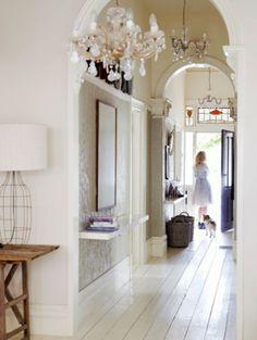 White wooden floor (+ love that metal construction lamp!)