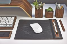 Grovemade   Walnut monitor stand, keyboard tray, leather wrist pad, leather mouse pad, succulent planters, pen cup, and ruler.