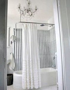 corrugated metal, chandelier, and beautiful shower curtain. Love it!
