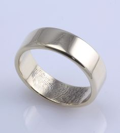 Love this!!!! The bride can personalize it for her man!!! Fingerprint wedding ring.