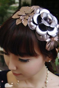 The leather garland headband crafted in PU of high quality, featuring exquisite three leather look flowers of different colors fastening to a slim band.