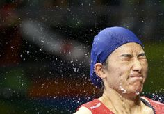 2016 Rio Olympics - Boxing - Semifinal - Women's Middle (75kg) Semifinals Bout 265 - Riocentro - Pavilion 6 - Rio de Janeiro, Brazil - 19/08/2016. Li Qian (CHN) of China reacts as she is splashed with water before her bout. REUTERS/Peter Cziborra