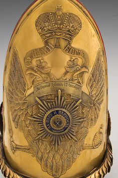 A Russian Pavlovski grenadier officer's mitre helmet, c.1877, with the Russian double-headed imperial eagle.