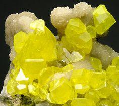 Sulfur crystals on a rich Calcite matrix. Ukraine