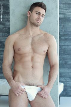 Hairy hunk Kirill Dowidoff goes shirtless and shows some sexy body hair captured by Artem Subbotin. Kirill is gorgeous guy with an awesome chest hair and all and the best bit – showing the top of his pubes.