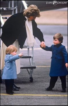 Princess Diana with Princes William and Harry.