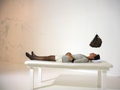 """""""The Treatment""""  by Juliana Engberg.  In this room, your body becomes an essential part of your own recovery. Visitors are invited to lie on a bed, over which a meteorite is suspended. Your face and head are in direct line of the rock, which has an enormous weight and strange magnetic presence.Your body becomes an essential part of your own recovery."""