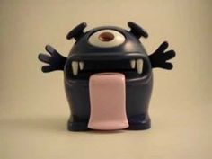 """""""Paper money makes Gobble very happy!"""" Money Monster Piggy Bank In Action as he eats your money. (video)"""