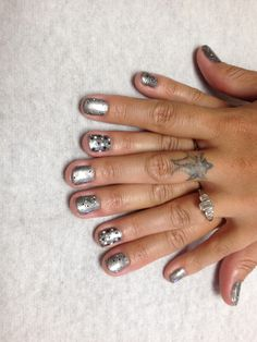 Grey with black and white confetti and black and white poke a dots on accent nails  Oasis Salon and Spa Mill Hall Pa (570)726-6565