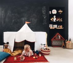 It's been snow for days here. And while it's pretty and lovely it's keeping us indoors more than I'd like so to make things more playful inside we brought out table tent from my book Playful: Fun Proj