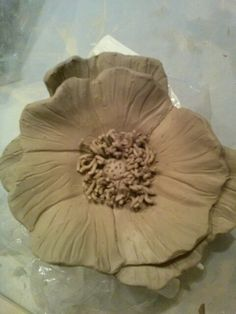 Porcelain Poppy flower prior to bisque firing.
