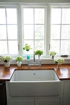 undermount farmhouse sink and butcher's block countertop