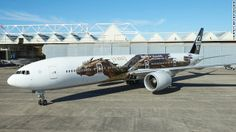 Air New Zealand publishes stunning pictures of Hobbit dragon Smaug – voiced by Benedict Cumberbatch – on the side of one of its planes. Hobbit Art, O Hobbit, Hobbit Dragon, Air New Zealand, Auckland, Trains, Plane Photos, Passenger Aircraft, Desolation Of Smaug