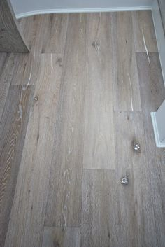 maybe tile that looks like this wood flooring? love the driftwood tone.