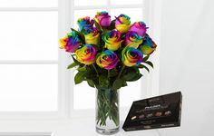 These vibrantly coloured roses come wrapped and tied with a ribbon and can be delivered with a personal message; chocolates are included too