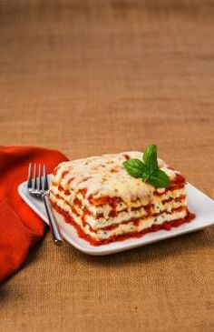 Classic Cheese Lasagna: Galbani Whole Milk Ricotta Cheese, Galbani Whole Milk Mozzarella Cheese, Parmesan, 5 to 6 cups of pasta sauce, box of no boil