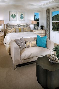 beautiful master bedroom with sitting area, turquoise, cozy farmhouse style interiors