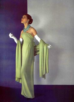 Model in beautiful fluid green crêpe evening gown, narrow belt is tied on the sides worn with matching stole by Christian Dior, photo by Pottier, 1956