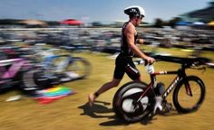 Australian Paul Matthews, preparing to transition from the bike to running, won the 2012 Memphis in May Triathlon in Tunica.