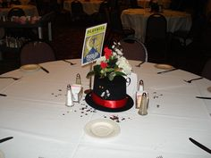 Simple Table Centerpiece with Top Hat and Flowers, and a Playbill Table Sign