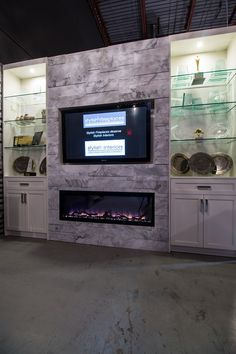 Wall to wall white: @Dimplex XLF50 electric #fireplace, set into @Erthcoverings White Wolf Strips stone, flanked by custom #white #cabinetry.