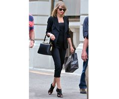 Taylor Swift in a chic, black tailored outfit