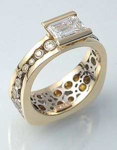 Karen's ring  18k yellow gold, 18k white gold, 1.4ct Vs emerald cut diamond, natural yellow, yellow/orange diamonds.