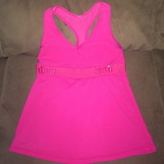 Lululemon Size Small Sports Tank Size small Lululemon sports bra tank . In great condition. No piling or stains has a padded bra with adjustable strap around ribs ! Lowest offer is the price listed . No trades or Merc color is pink . I cut the tag out because it was itchy . lululemon athletica Tops Tank Tops