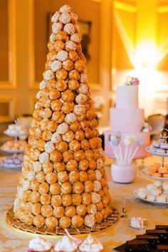 Lunchtime #Wedding Treat - How about an incredible croquembouche wedding #cake from @lepapilloncakes