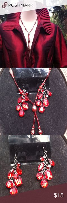 Ruby red glass necklace and earrings bundle Ruby red glass dangled cut earings and  lariat  style glass bead necklace ... Great accent pieces...Jaipur button front blouse sold in separate listing ...a 'Kristens Find' posh on girlfriend;) Jewelry Necklaces