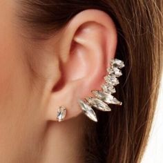 """T&j Designs Crystal Studs and Wing Cuff Just in! These gorgeous earrings are from the T+j Designs Collection which launched in the Poshmark Wholesale Portal! 15% off bundles of 2+ items! Let me know if you have any questions!  Crystal wing ear cuff and stud set! Wear each piece on it's own or pair the two together for an ultra glam look!  1 cuff and 2 studs included Cuff: 2"""" x .5"""" Studs: .375"""" in diameter Cuff with clip back closure Cubic Zirconia stones T&J Designs Jewelry Earrings"""
