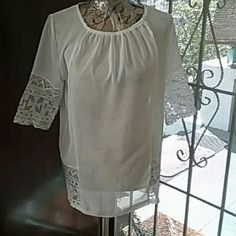 💲GOTTA GO 💲Blouse Blouse has white lace on sleeves and bottom back NWOT never worn very clean. Has small stretch around neck front. Tops Blouses