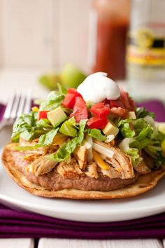 Loaded chicken tostadas layered with guacamole, refried beans, tomatoes, and chiles! Perfect for weeknights or game day. Tostadas are delicious and hearty comfort food. Slow Cooker Huhn, Slow Cooker Chicken, Slow Cooker Recipes, Crockpot Recipes, Chicken Recipes, Cooking Recipes, Healthy Recipes, Recipe Chicken, Cooking Tips