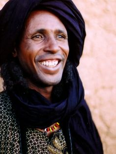 Africa | 'Wodaabe smile'.  Bororo (or Wodaabe as they prefer to call themselves) are nomadic herdsman that live between Senegal and Niger (but mostly Niger). They belong to the largest ethnic group of people in West Africa - the Fulani. | © Krzysztof Pakulski