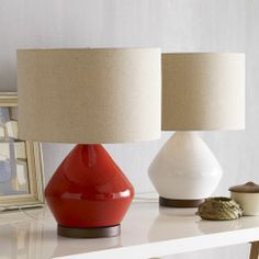 Buying this well-priced paprika colored mid-century inspired table lamp.