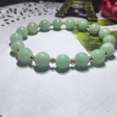 100% natural jade jadeite beaded bracelets with 18 carat gold beads. This authentic jade jadeite bracelet has already been imported from China and ready to ship