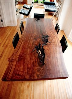 Wood Slab Table Shows True Elegance - http://www.interiordesignwiki.com/architecture/wood-slab-table-shows-true-elegance/
