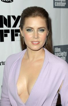 Amy Adams on the red carpet in a pale purple dress with a plunging sweeping open neck braless, star of American Hustle, Junebug, Enchanted, and Man of Steel, a modern classic beauty. #AmyAdams #redhead #redheads #redcarpet #downblouse