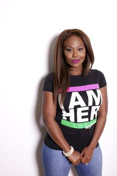2d08ced3 Female wearing black Women's Graphic Tee with saying, I AM HER with pink  and green