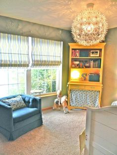 like the idea of a comfy seat in boys room, fluffy carpet, colorfull dresser, interesting light fixture