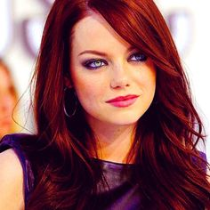 Emma Stone always has the best eye makeup! Great smokey eye, and love the dark red hair.