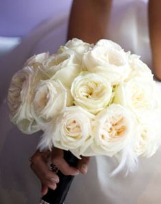 White rose bouquet with feather accents
