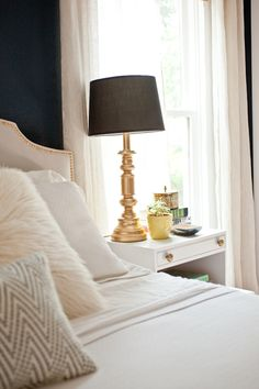 Playful navy bedroom (love this space but the crooked lampshade is killing me)