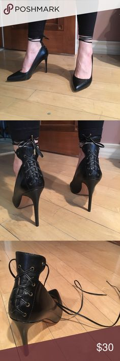"""NINE WEST Corset Stiletto NWOT Nine West black leather pointy toe stiletto heels with corset lace up detail and ankle ties. Worn only one time for a few hours. Size 8 1/2 but fits SMALL, more like an 8. Heel height is 4 1/2"""" . No signs of wear, except  on the sole there is a slight mark (see last photo) Nine West Shoes Heels"""
