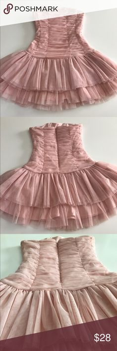 Strapless Pink Tutu Dress Pink Strapless Tutu Dress. Size is S. Comfortable and super cute. Great condition. Inside of dress has minor markings from hanger clamps. Dresses Strapless